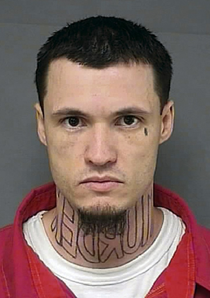 "The Associated Press This undated booking photo from the Kansas Department of Corrections shows Jeffrey Chapman, charged with first-degree murder in the November 2011 killing of Damon Galliart. After his attorney claimed it would be prejudicial, Chapman will be allowed to wear a turtleneck to cover a tattoo on his neck of the word ""murder"" spelled backward when his trial begins in August 2014."