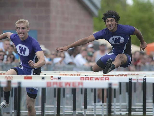 Staff photo by Michael York Meet: Waterville High school Boys hurdlers Troy Gurski, left, and Shahzaib Khan, compete in the 110 meter hurdles in the State Class B track meet on Saturday in Brewer.