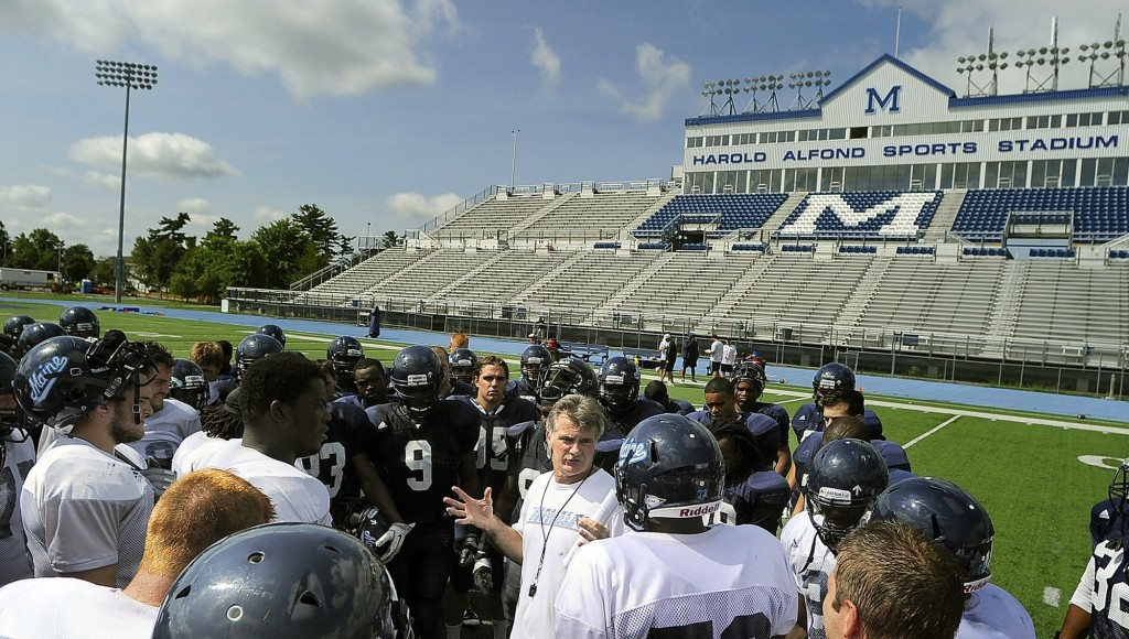 Black Bears head coach Jack Cosgrove speaks with his team at the end of a practice. The team was picked to finish seventh of 12 schools this season during the annual CAA media day. 2012 Press Herald File Photo/Gabe Souza