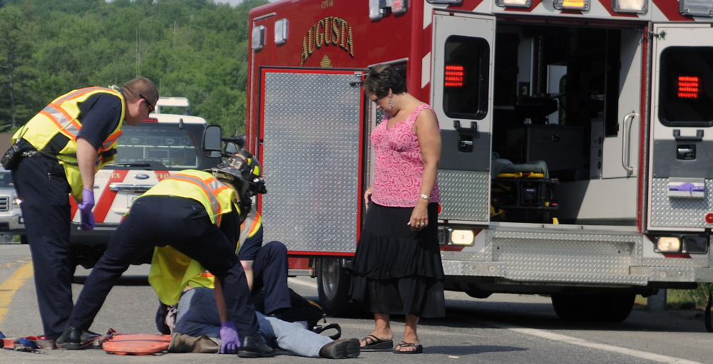 AUGUSTA, ME - City of Augusta paramedics treat a man Tuesday injured on an on ramp to Interstate 95 in Augusta.