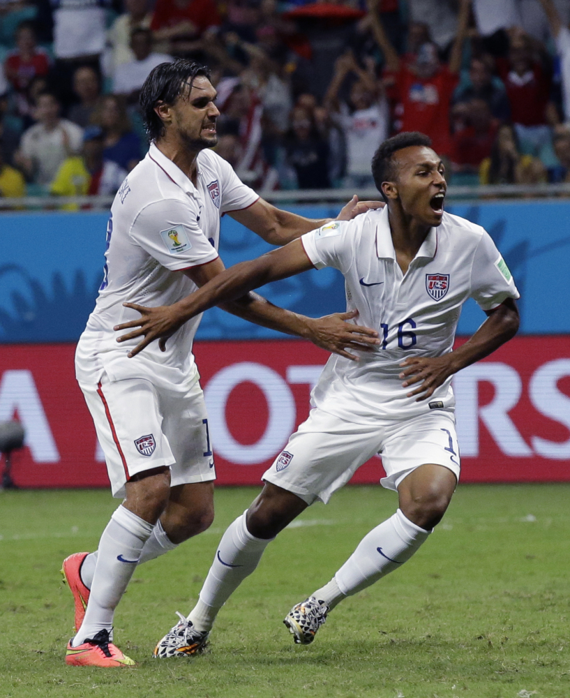 United States soccer player Julian Green, right, celebrates after scoring his side's first goal during the knockout round match between Belgium and the US on Tuesday at the Arena Fonte Nova in Salvador, Brazil. Belgium beat the US 2-1.