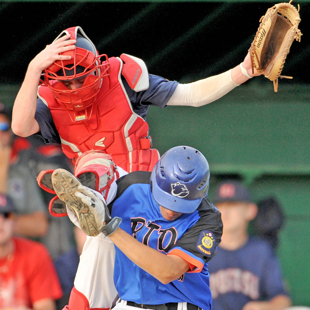 Post 51 catcher Josh Woodard (3) jumps for the ball as RTD of Madison's Chase Nelson collides with him at home plate Tuesday at Colby College in Waterville. RTD defeated Post 51 5-2.