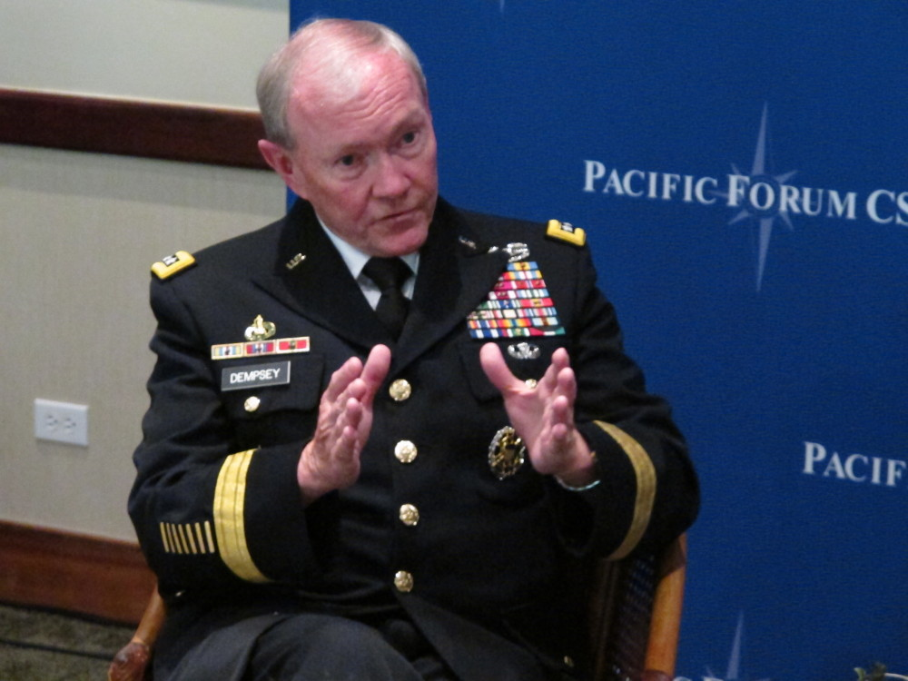 Gen. Martin Dempsey, chairman of the Joint Chiefs of Staff, speaks to reporters after a forum on military issues in Honolulu on Tuesday.