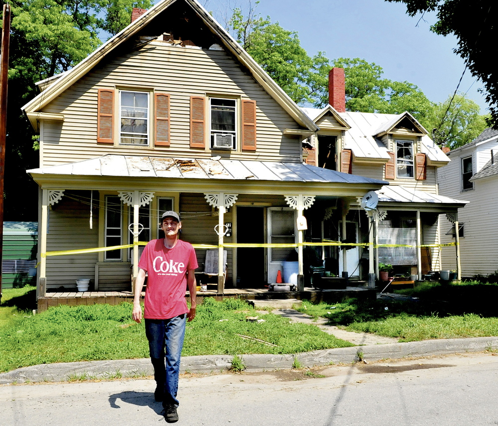 Steve Shorey on Wednesday walks away after looking at his neighbor's home at 20 Milburn St. in Skowhegan that received extensive damage from fire on Tuesday evening. Shorey said that firefighters got the five tenants out and evacuated neighboring homes.