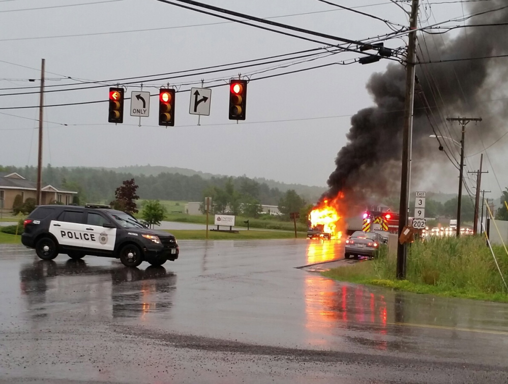 The cab of a tractor-trailer burns near the intersection of Route 3 and Church Hill Road in Augusta Wednesday night.