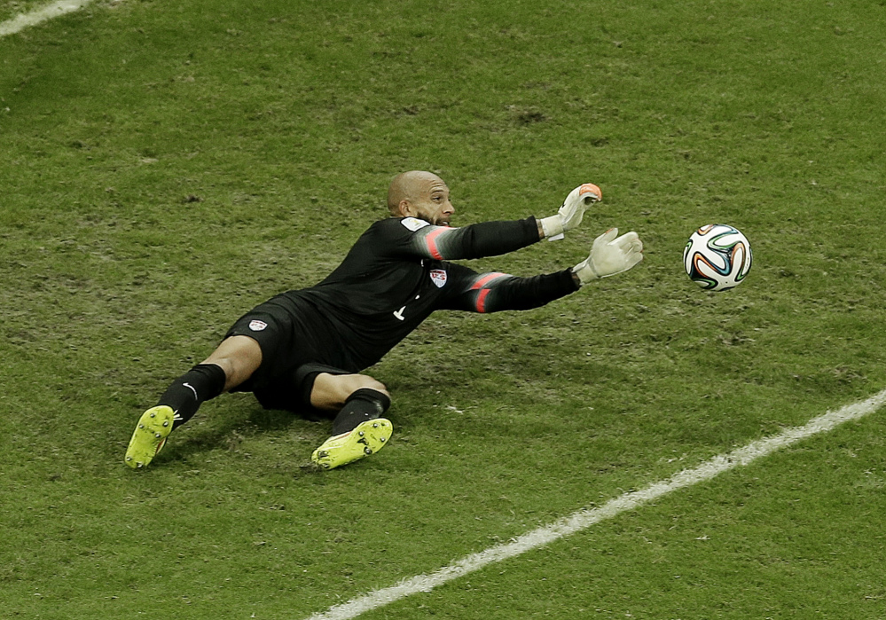 United States goalkeeper Tim Howard makes a save during the World Cup Round of 16 soccer match between Belgium and the USA on Tuesday at the Arena Fonte Nova in Salvador, Brazil. Howard made 16 saves, but the US lost 2-1.