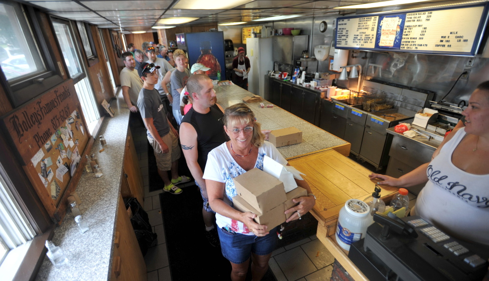 A line stretches out the door Thursday at Bolley's Famous Franks on College Avenue in Waterville. The landmark lunch destination served its last hot dog Thursday, ending a 52-year run.