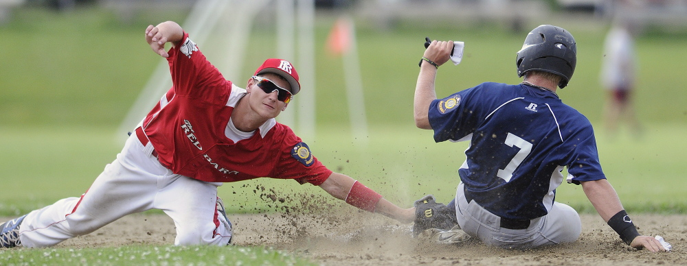Gardiner's Kyle Fletcher slides safely Thursday beyond the tag of Red Barn's Tyler Bailey into second base during an American Legion baseball match-up in Monmouth.