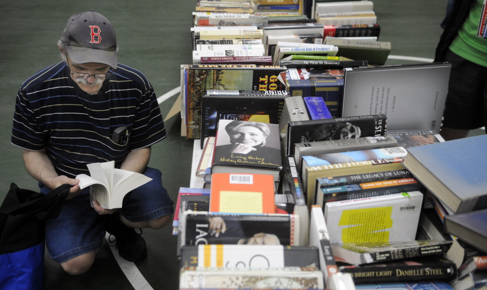 Visitors at the Center For All Seasons in Belgrade browse books for sale. While some of the town's Fourth of July events were postponed because of rain, the Belgrade Public Library's annual book sale went off without a hitch, though it was moved into the center from outdoors in the village.
