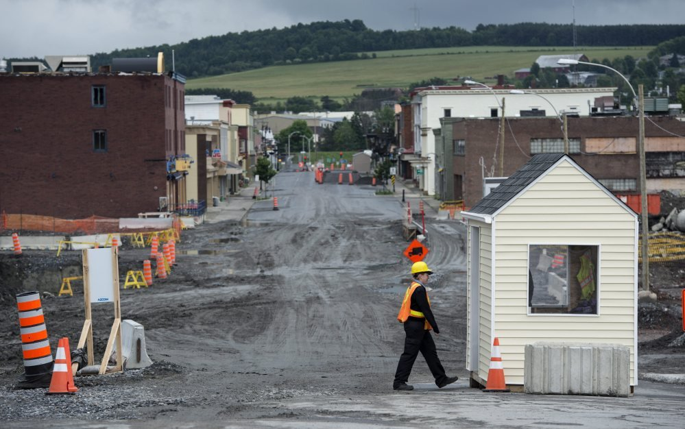 The main street of Lac-Megantic, Quebec, remains closed Friday, July 4, 2014. A year has passed since a runaway oil train slid quietly down a hill in the middle of the night and derailed in a series of explosions that obliterated a large swath of downtown Lac-Megantic, killing 47 people. Paved roads and new buildings remain a long way off in the fenced-off disaster zone. The damage to the surrounding river system hasn't been fully made public, and the environmental cleanup alone will cost at least $200 million.