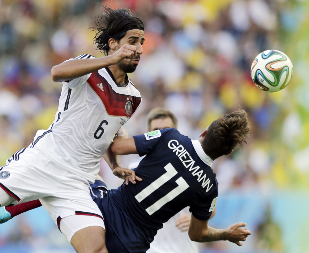 Germany's Sami Khedira heads the ball against France's Antoine Griezmann on Friday at the Maracana Stadium in Rio de Janeiro, Brazil. Germany beat France 1-0 and will meet Brazil in the World Cup semifinals Tuesday.