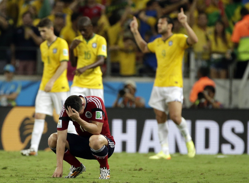 Colombia's James Rodriguez hangs his head in disappointment at the end of the World Cup quarterfinal soccer match between Brazil and Colombia on Friday at the Arena Castelao in Fortaleza, Brazil. Brazil won the match 2-1.