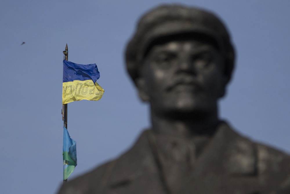 A Ukrainian flag is seen over a government building in the city of Slovyansk, Donetsk Region, eastern Ukraine on Saturday with a statue of Soviet Union founder Vladimir Lenin on the left. Ukraine's forces claimed a significant success against pro-Russian insurgents on Saturday, chasing them from one of their strongholds in the embattled east of the country. Rebels fleeing from the city of Slovyansk vowed to regroup elsewhere and fight on.