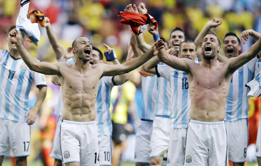 Argentina's Javier Mascherano, left, and his teammates celebrate following their 1-0 victory over Belgium to advance to the World Cup semifinals at the Estadio Nacional in Brasilia, Brazil, on Saturday.