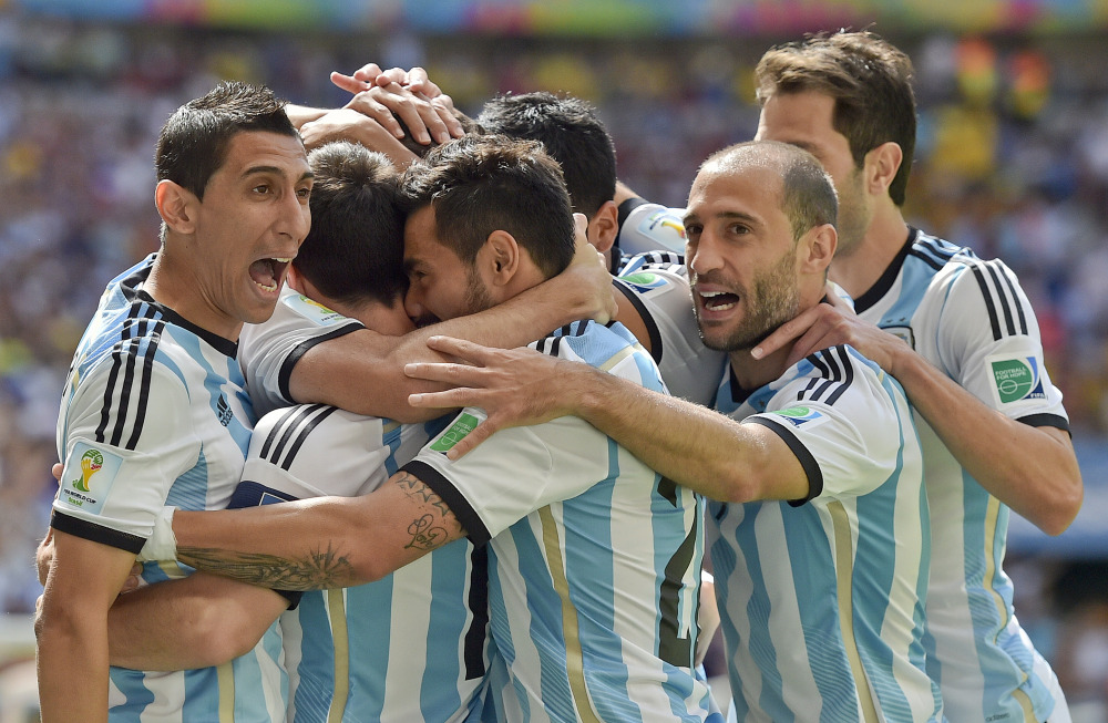 Argentina players celebrate after Gonzalo Higuain scored against Belgium in the World Cup quarterfinals Saturday at the Estadio Nacional in Brasilia, Brazil. Argentina won, 1-0.