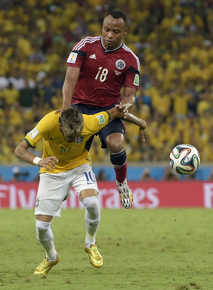 Brazil's Neymar is fouled by Colombia's Juan Zuniga during the World Cup quarterfinal soccer match between Brazil and Colombia at the Arena Castelao in Fortaleza, Brazil, on Friday.