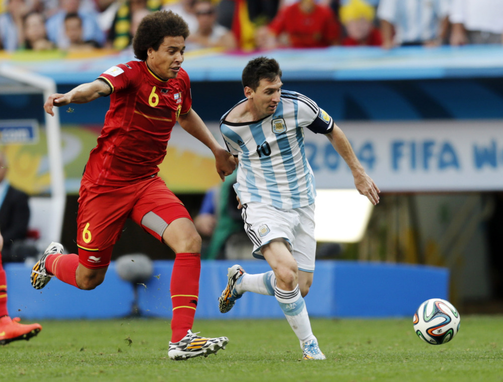Argentina's Lionel Messi controls the ball as Belgium's Axel Witsel grabs him by the jersey Saturday during the World Cup quarterfinals at the Estadio Nacional in Brasilia, Brazil. Argentina won 1-0.