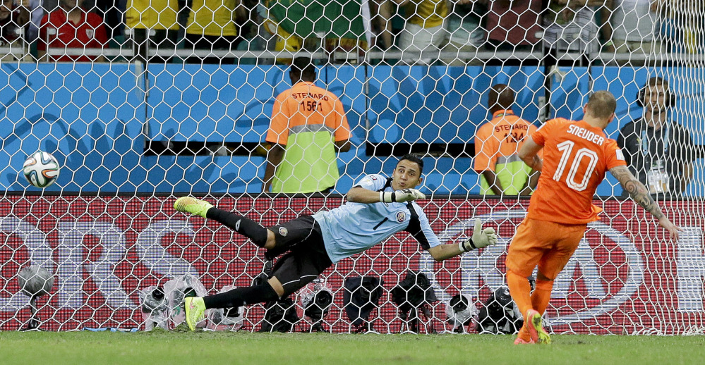 Netherlands' Wesley Sneijder scores in a penalty shoot out during the World Cup quarterfinals at the Arena Fonte Nova in Salvador, Brazil. The Netherlands won 4-3 on penalty kicks after the match ended 0-0 after extra time.