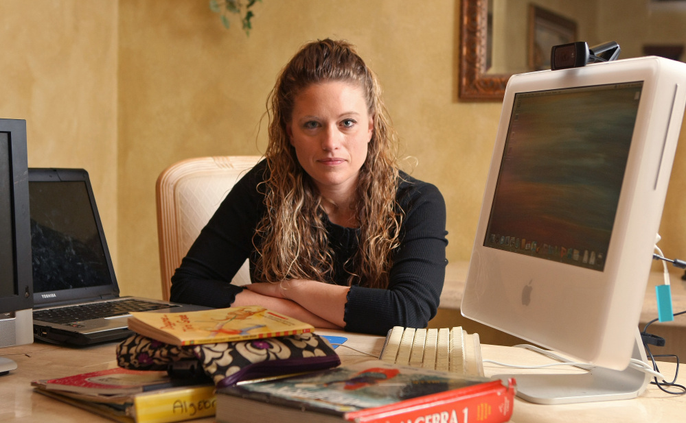Jennifer Wedel of Fort Worth, Texas is photographed at her home after chatting with President Obama via Google. Wedel challenged President Obama on the H-1B visa issue in 2012, making headlines when she asked him via a public online chat about the number of foreign workers being hired, given that her husband, a semiconductor engineer, couldn't find work.