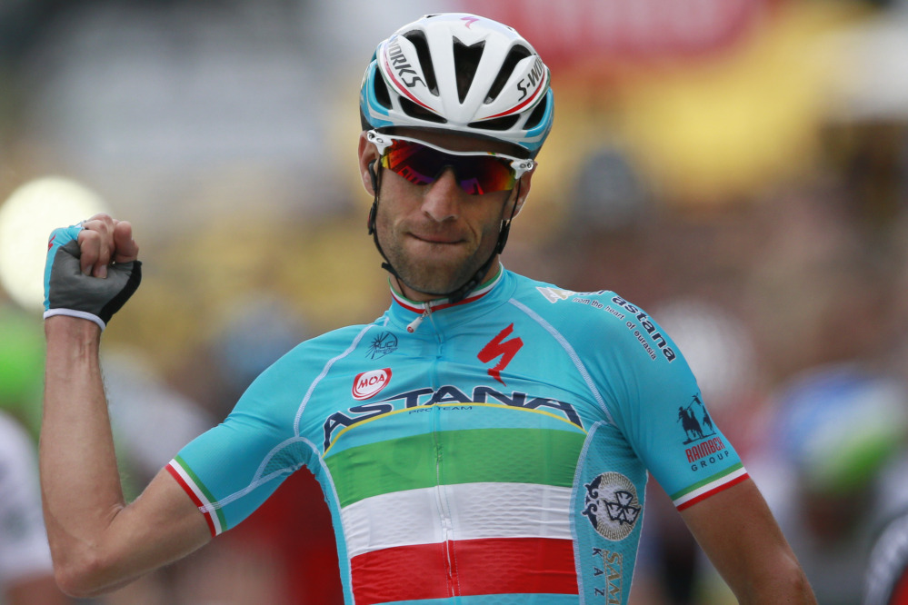 Italy's Vincenzo Nibali crosses the finish line to win the second stage of the Tour de France Sunday in Sheffield, England.