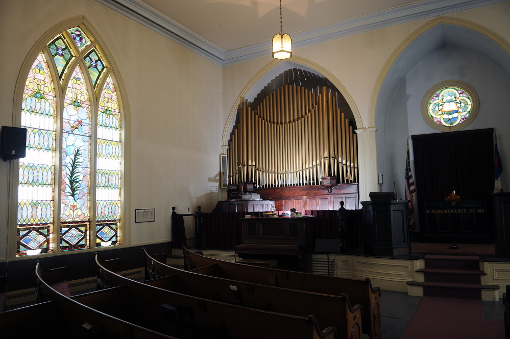 Kristina Nugent and David Boucher plan to keep a pipe organ inside the 19th century church in Gardiner they plan to purchase and convert into a cider brewery. The couple visited the former church on Sunday July 6, 2014.