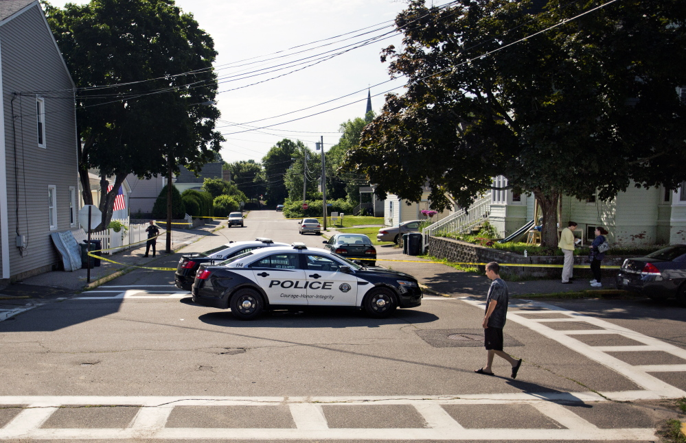 Police block off West Cutts Street at the corner of Western Avenue in Biddeford on Monday as they investigate Sunday's shooting that left two men dead at 19 Western Ave.