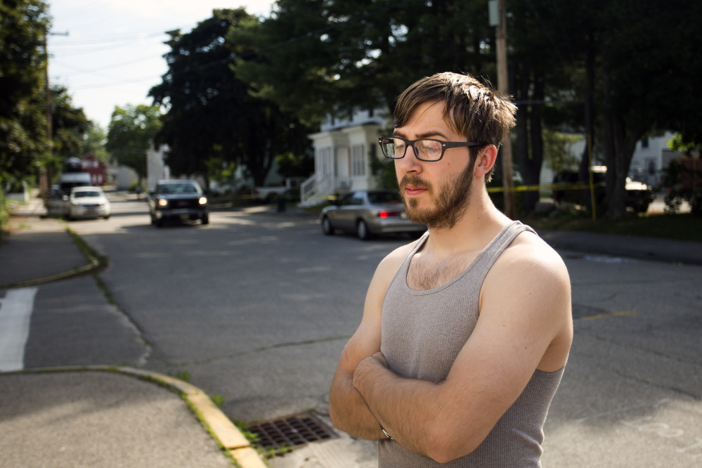 BIDDEFORD, ME - JULY 7: Goliath Vanalehen, who lives in one of the apartments at 19 Western Avenue in Biddeford, reacts Monday, July 7, 2014, the morning after two men were shot in the building and later died, one at Maine Medical Center in Portland and the other in the ambulance. Danalehen said his pets are still in the apartment but police still had the scene roped off as of 10 am Monday. (Photo by Gabe Souza/Staff Photographer)
