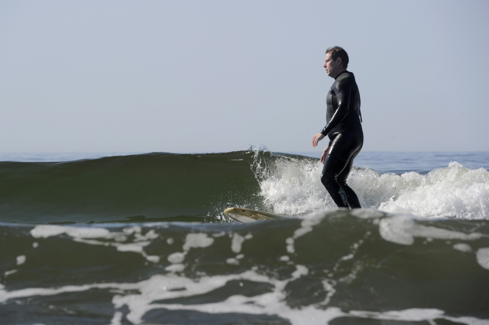 KENNEBUNK, ME - JUNE 28: Justice John O'Neil, who sits in York County Superior Court, surfs at Kennebunk Beach on Saturday, June 28, 2014. (Photo by Logan Werlinger/Staff Photographer)