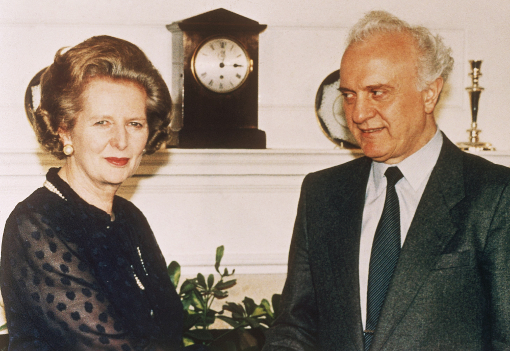 British Prime Minister Margaret Thatcher welcomes Soviet Foreign Minister Eduard Shevardnadze on his arrival at her 10 Downing Street residence in London in this July 1986 photo.