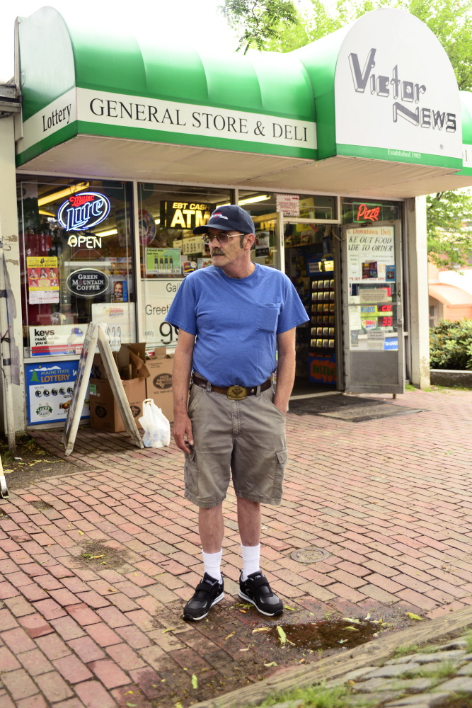 John Gulbert stands in front of the Victor News corner store on Park Street in downtown Lewiston on Thursday, June 26, 2014. Gulbert has lived in Lewiston for 54 years and believes the merger of Lewiston and Auburn would revive the downtown that has declined in the last 20 years.