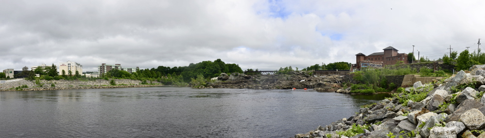 Auburn and Lewiston, separated by the Androscoggin River and pictured on Thursday, June 26, 2014, are discussing merging the cities and presenting it to the community for a local vote.