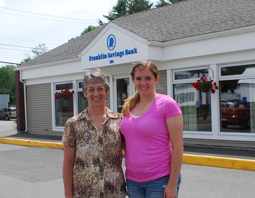 Madison Area Memorial High School Scholar Emily McKenney of Madison, with Skowhegan Branch Manager Sally Dwyer.