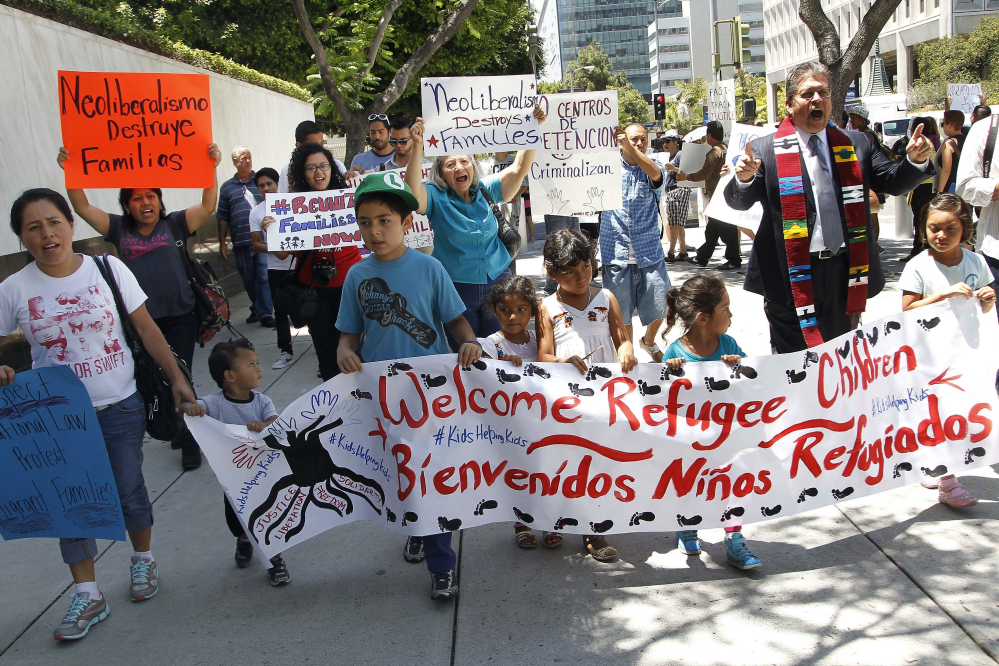 Immigrant families and children's advocates rally in response to President Barack Obama's statement on the crisis of unaccompanied children and families illegally entering the United States, outside the Los Angeles Federal building Monday.