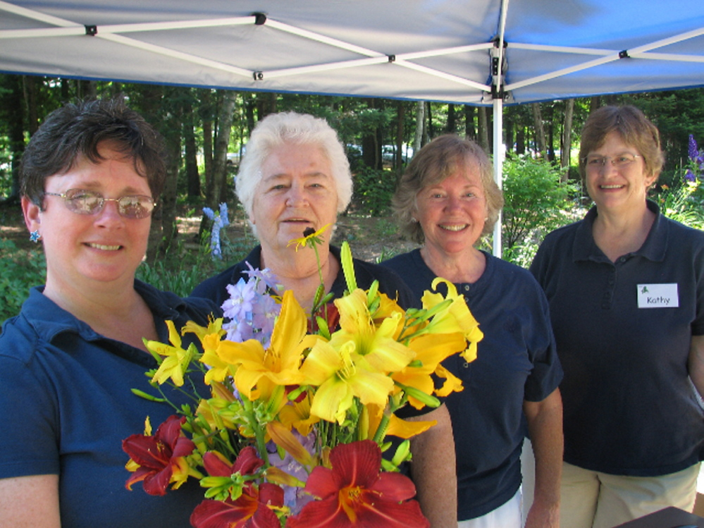 Maine-ly Harmony members Jan Flowers of Winterport, Gerry Dostie of Augusta, Sheryl Whitmore of Auburn and Kathy Greason of Hallowell welcome folks to last year's  fundraiser.
