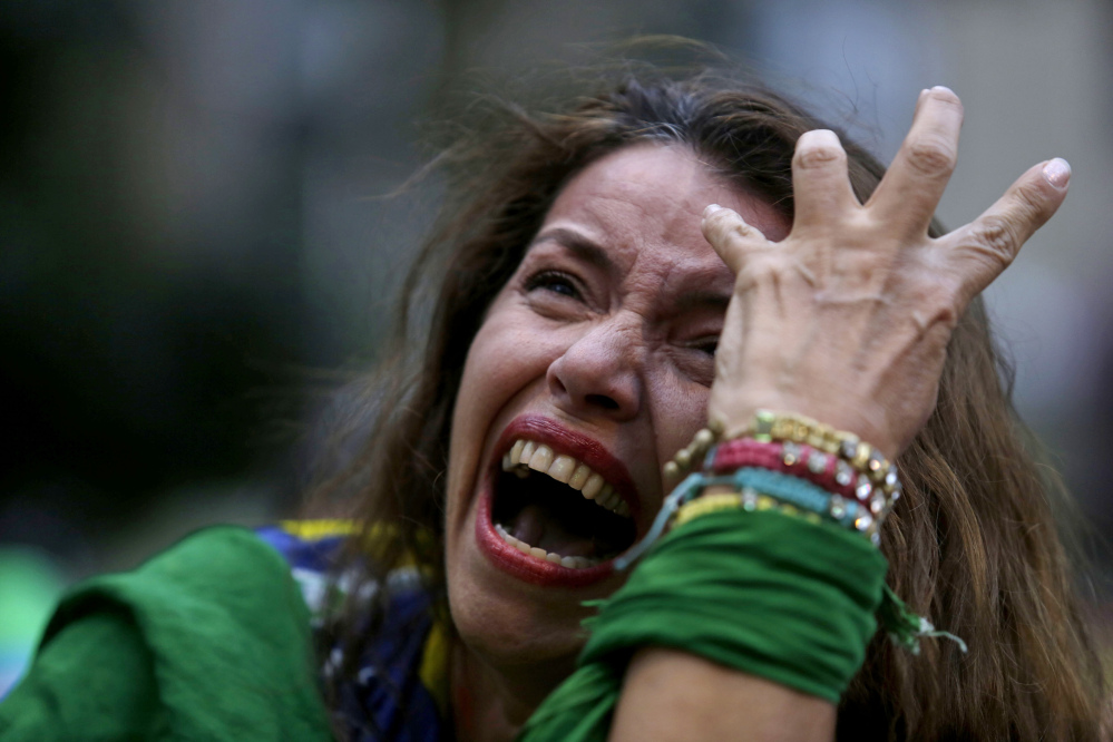 A Brazilian soccer fan cries as Germany scores against her team in Tuesday's semifinal World Cup match.