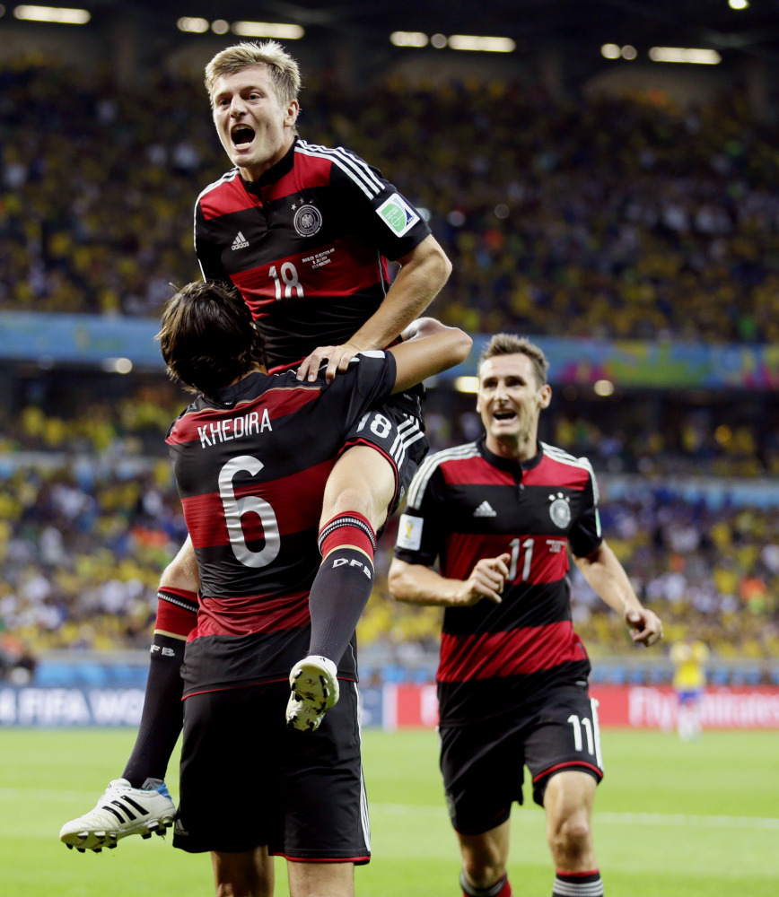 Germany's Toni Kroos celebrates with Sami Khedira (6) and Miroslav Klose (11) after scoring his team's fourth goal Tuesday.