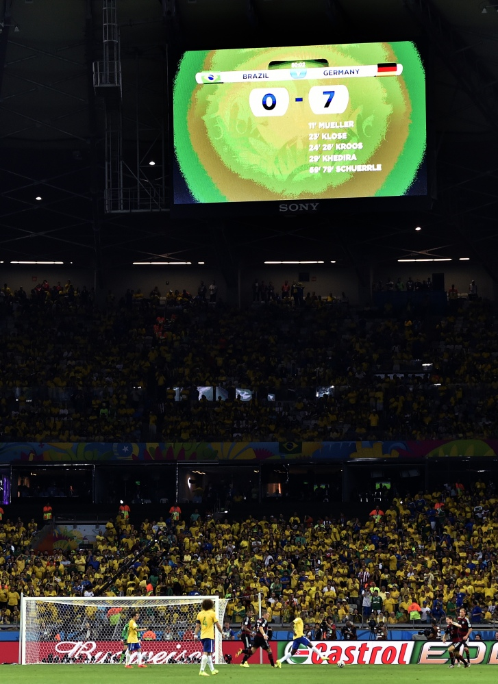 The scoreboard reads 0-7 during Tuesday's World Cup semifinal match between Brazil and Germany.