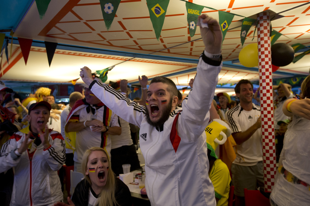 Fans of the German national soccer team on Copacabana Beach, in Rio de Janeiro, celebrate a goal during the semifinal match between Germany and Brazil.