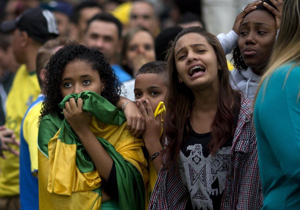 Brazilian soccer fans watch on TV in Sao Paulo as their team loses to Germany on Tuesday.