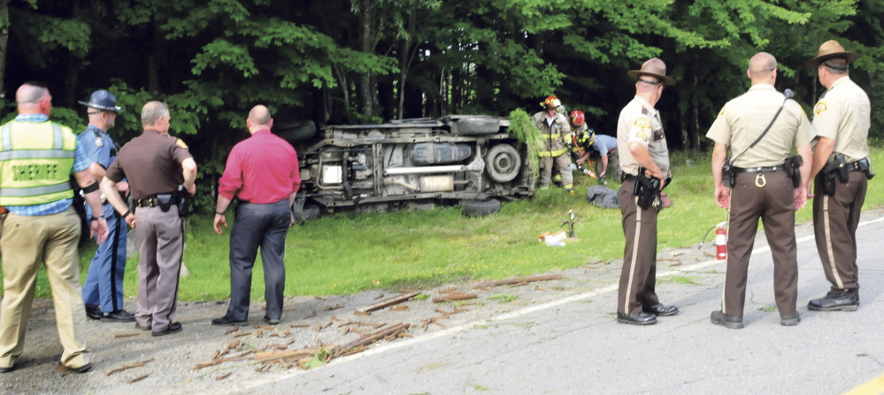 Staff photo by David Leaming. A high-speed chase that ended Tuesday afternoon on Main Stream Road involved a stolen vehicle carrying stolen scrap metal. The driver and another occupant were taken to the hospital after the vehicle rolled over.