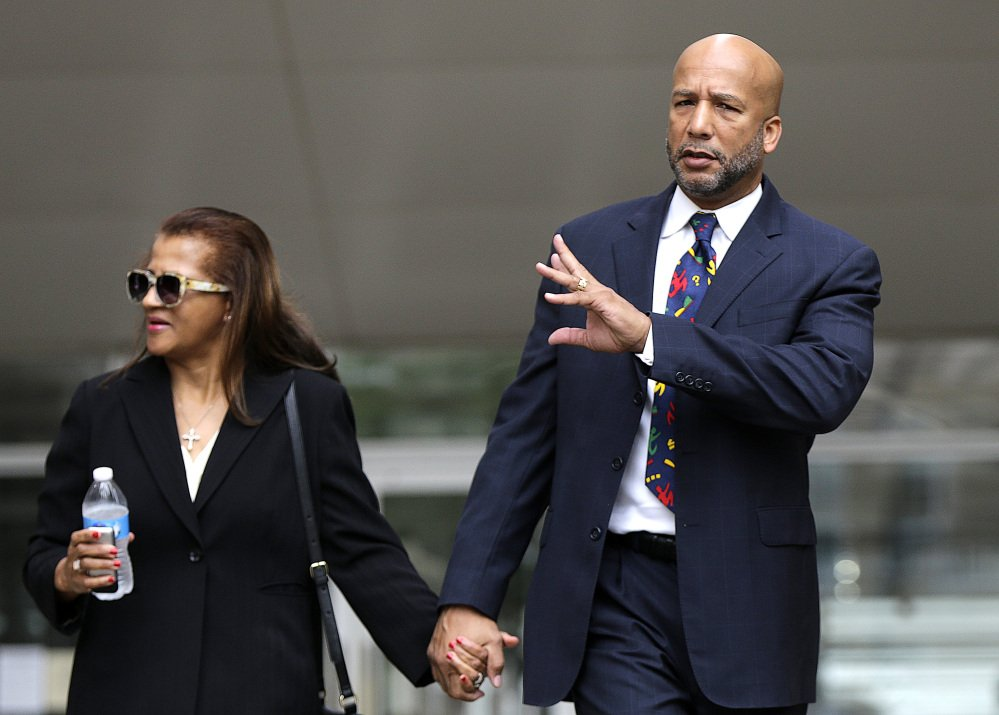 Former New Orleans Mayor Ray Nagin leaves federal court with his wife, Seletha Nagin, after being sentenced in New Orleans on Wednesday.