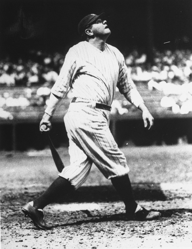 In this 1927 file photo, Babe Ruth lofts another home run into the right field upper deck at Yankee Stadium in New York on the way to his 60-home run year.