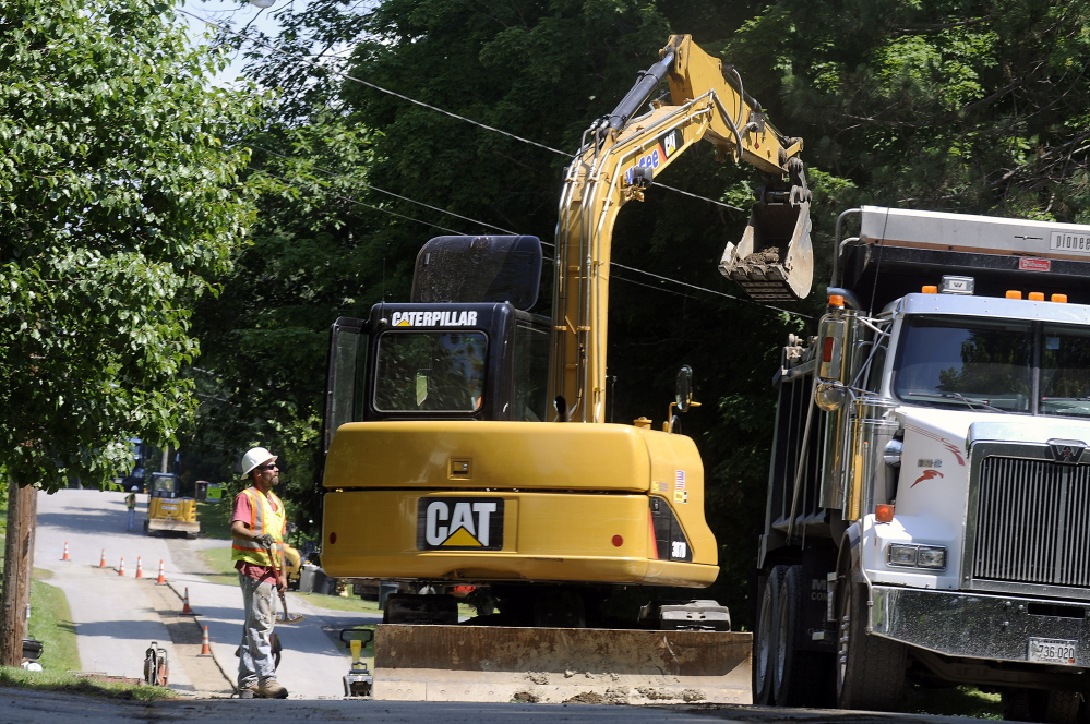 McGee Construction employees work Tuesday on Greenville Street in Hallowell as part of natural gas expansion into the city.