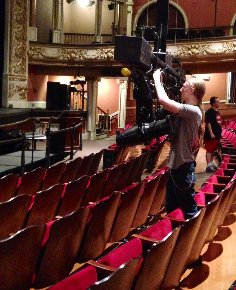 Isaac Woods, a tech assistant at the Opera House, completes final preparations for the Maine International Film Festival