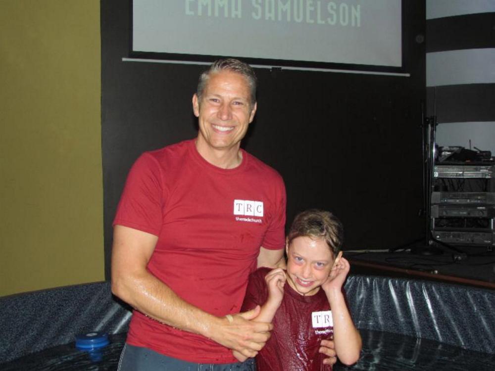 Pastor Eric Samuelson with his daughter Emma after she was baptized