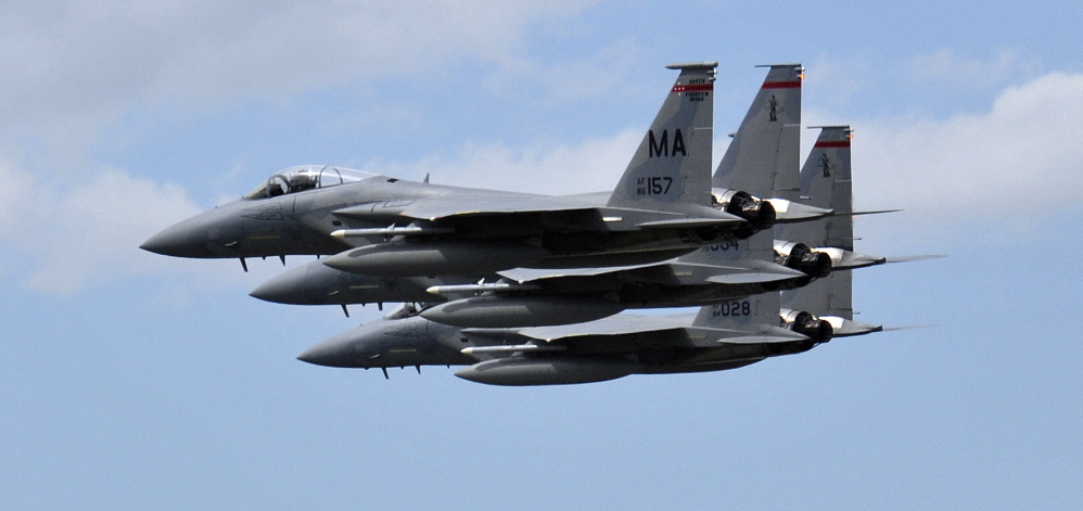 Lt. Col. Eric Samuelson, 46, made a final flight in a high-performance F-15, buzzing the Portland International Jetport, where members of the congregation where he is pastor gathered to cheer for him Thursday. He was flying with two other F-15s.