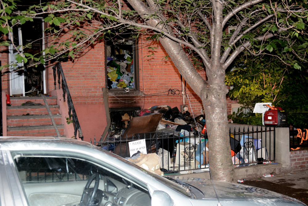 Debris is piled up after a fire broke out in the basement in Jersey City, N.J., rowhouse, killing a 32-year-old Stephanie Britton. Firefighters had a hard time getting to Britton, who died on the second floor because of an extreme amount of clutter, according to Jersey City Fire Chief Darren Rivers.