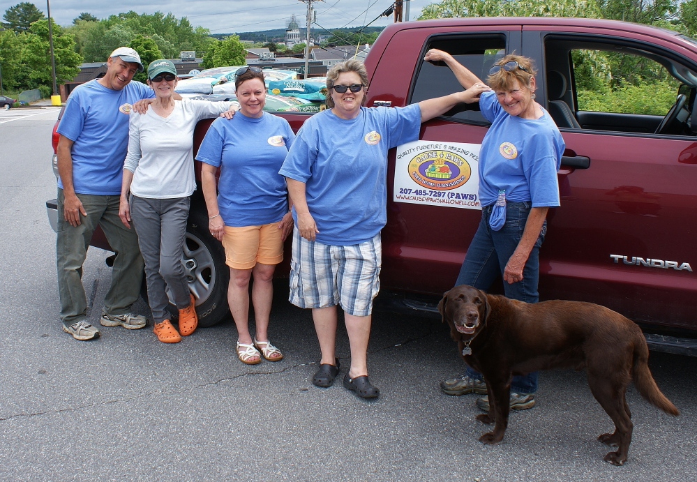 Cause 4 Paws in Hallowell recently held a pet food drive to benefit the Amy Buxton Pet Pantry. From left, picking up donated pet food from Pet Life and the Shaw's Plaza in Augusta, are Marc Poirier, Mary Pillsbury, Dee DeHaas, Cause 4 Pause Laurel Rouillard, Myra Macfie and dog Buster.