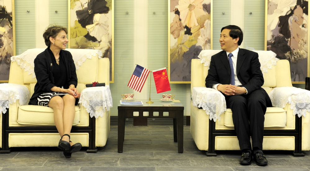 University of Maine at Farmington President Kathryn Foster meets with Guo Guangsheng, her counterpart at Beijing University of Technology, in Beijing during an event commemorating the 25th anniversiary of a collaboration between the two institutions.