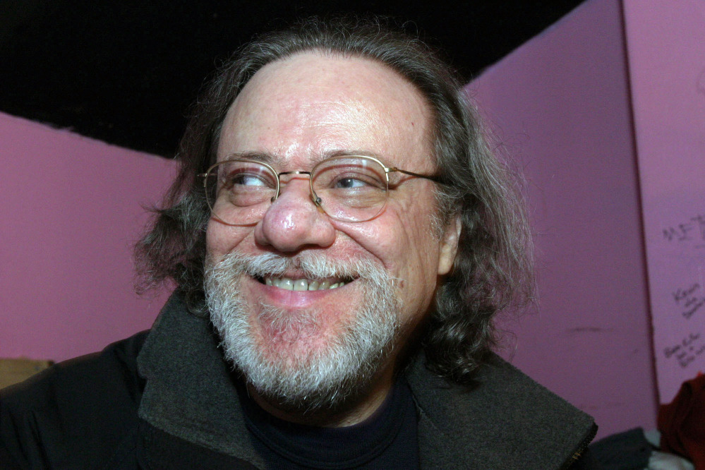In this Jan. 8, 2005, photo, Tommy Ramone, ex-drummer and manager of The Ramones, smiles as he is interviewed backstage at the Knitting Factory in New York. A business associate says Ramone, a co-founder of the seminal punk band The Ramones and the last surviving member of the original group, has died. He was 65.